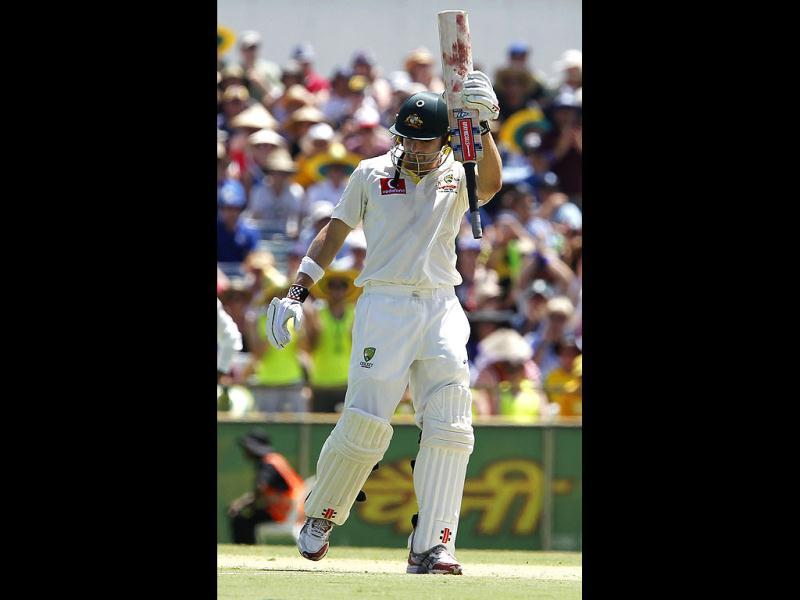 Ed Cowan acknowledges the crowd after hitting 50 runs against India on the second day of their cricket Test match at the WACA in Perth. AP