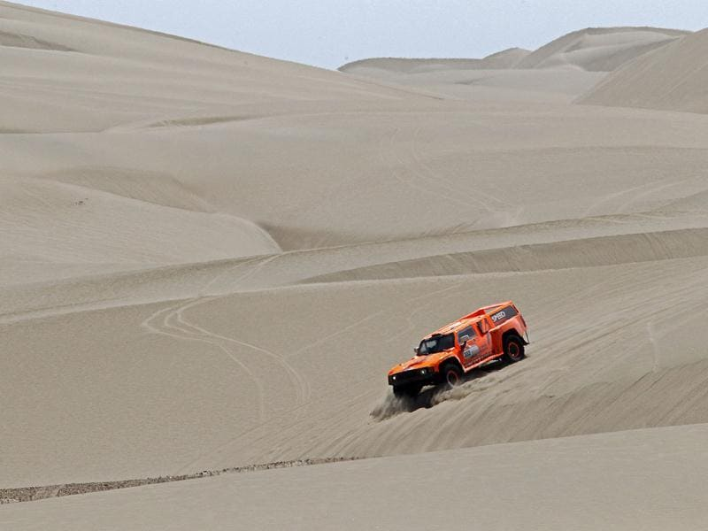 Robby Gordon of the US and co-pilot Johnny Campbell drive their Hummer during the 12th stage of the fourth South American edition of the Dakar Rally 2012 from Arequipa to Nasca. Reuters photo/Jacky Naegelen
