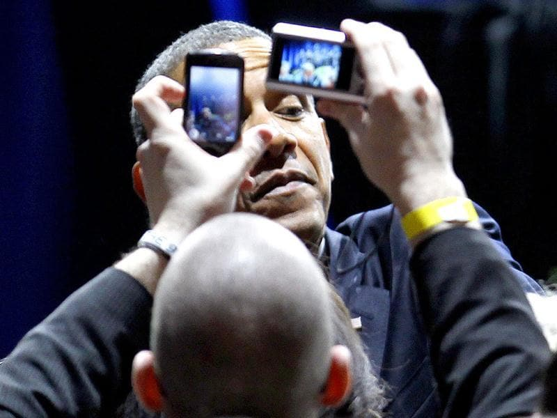 President Barack Obama works the crowd during a campaign event in Chicago. AP photo/Charles Rex Arbogast