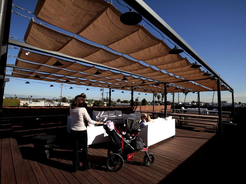 Women sit on the roof deck at the Google campus near Venice Beach, in Los Angeles, California. Reuters