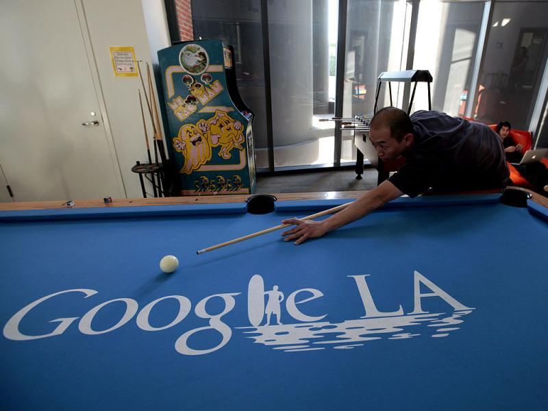 An employee plays pool at the Google campus near Venice Beach, in Los Angeles, California. Reuters