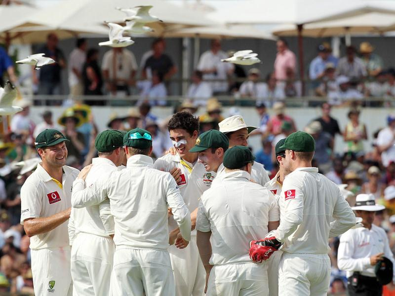 Australian fast bowler Mitchel Starc (C, without cap) celebrates with teamates after taking the wicket of Gautam Gambhir on day 2 of the third cricket Test match against India in the Border-Gavaskar Trophy Series at the WACA ground in Perth. -AFP Photo