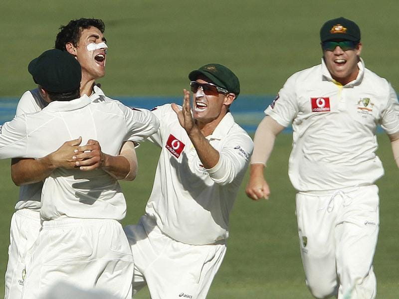 Mitchel Starc (2nd L) of Australia celebrates taking the wicket of Sachin Tendulkar during the second day of their third cricket test at the WACA in Perth. -Reuters