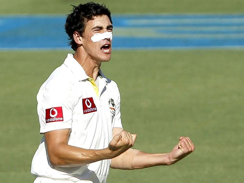 Mitchell Starc of Australia celebrates taking the wicket of Sachin Tendulkar during the second day of their third test cricket match at the WACA in Perth. -Reuters