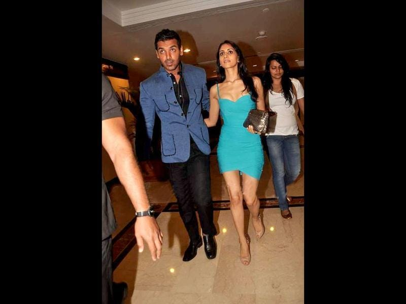 John Abraham seems quite happy with the beauty with brains.