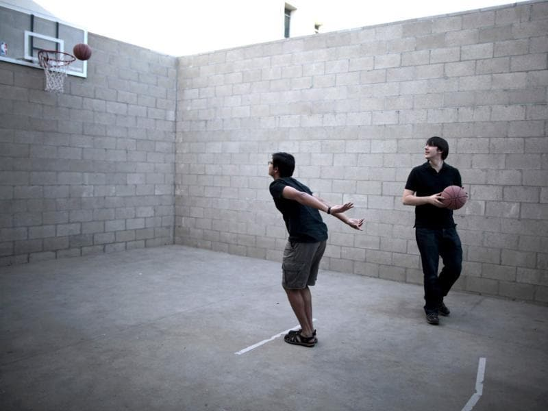 Software engineer Madhava Srinivasan (L) shoots hoops at the Google campus near Venice Beach, in Los Angeles, California. (Reuters/Lucy Nicholson)