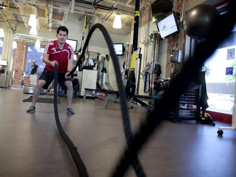 Performance specialist David Delgado demonstrates a rope exercise in the company gym which is open 24 hours at the Google campus near Venice Beach, in Los Angeles, California. Around 500 employees develop video advertising for YouTube, parts of the Google+ social network and the Chrome Web browser at the site. (Reuters/Lucy Nicholson)