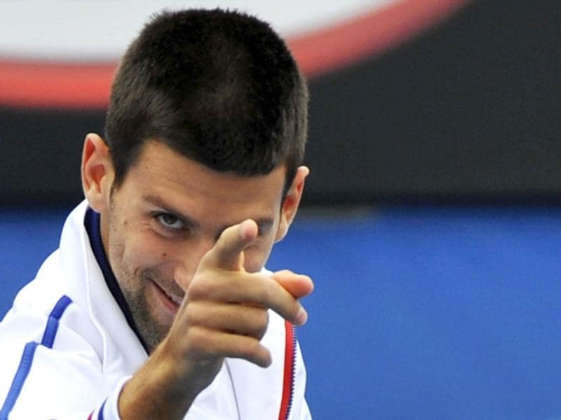 Novak Djokovic of Serbia gestures during a practice session before the Australian Open tennis tournament in Melbourne. (Reuters/Toby Melville)