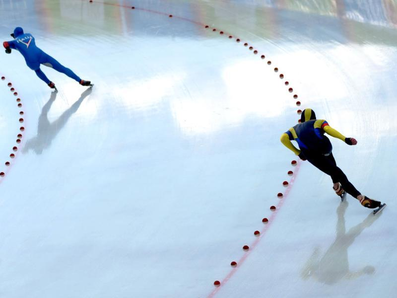Matteo Cotza of Italy (L) and Dmitriy Morozov of Kazakhstan compete during 500m men's speed skating at the winter Youth Olympic Games in Innsbruck. (AFP Photo/Samuel Kubani)