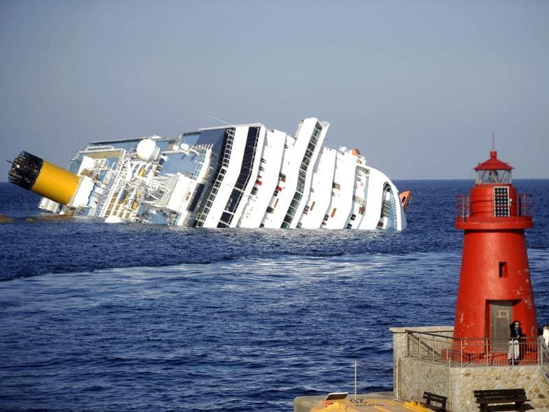 View of the Costa Concordia after the cruise ship ran aground and keeled over off the Isola del Giglio. (AFP Photo/Filippo Monteforte)