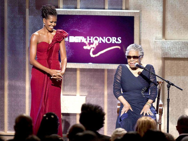 First Lady Michelle Obama stands by BET honoree author Maya Angelou at the BET Honors in Washington. Reuters