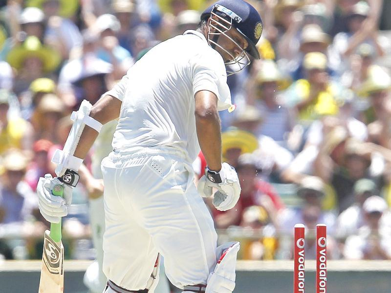 Rahul Dravid looks at his stumps after being bowled for 47 runs against Australia on the third day of their cricket test match at the WACA in Perth, Australia. Australia made 369 in their first innings. AP