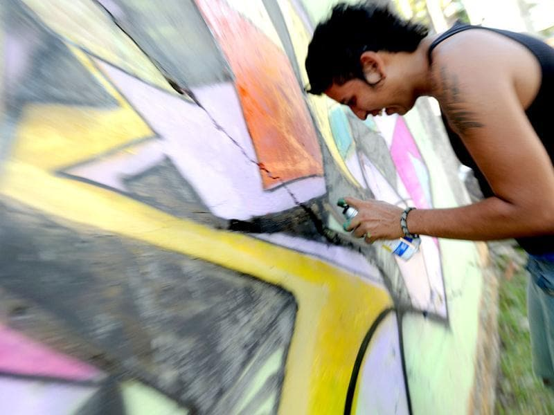 A man paints a graffiti during a demosntration of