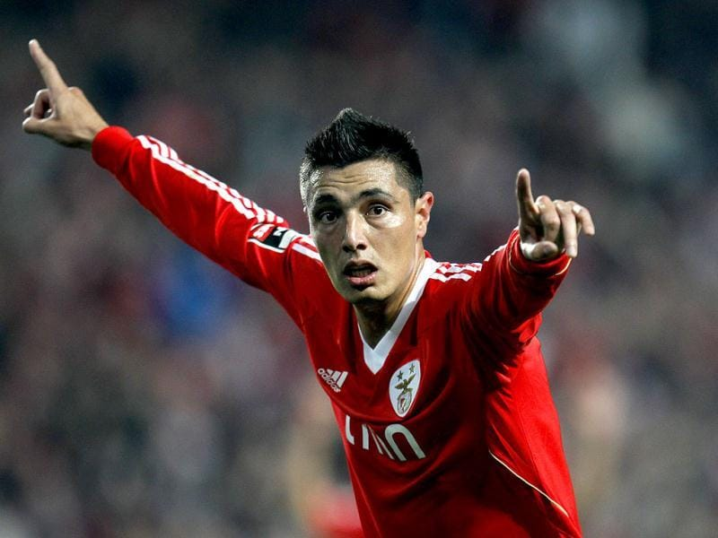 Benfica's Oscar Cardozo, from Paraguay, celebrates after scoring their second goal against Vitoria de Setubal during their Portuguese league soccer match at Benfica's Luz stadium in Lisbon. AP