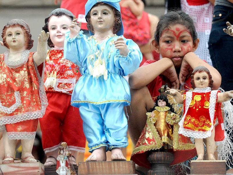 Thousands of residents of Manila's Tondo district carry small religious icons of baby Jesus in the annual Sto Nino feast. The Sto Nino feast is one among dozens of religious festivals honouring various saints and religious icons, a legacy of three centuries of Spanish rule across the archipelago. AFP photo/Jay Directo