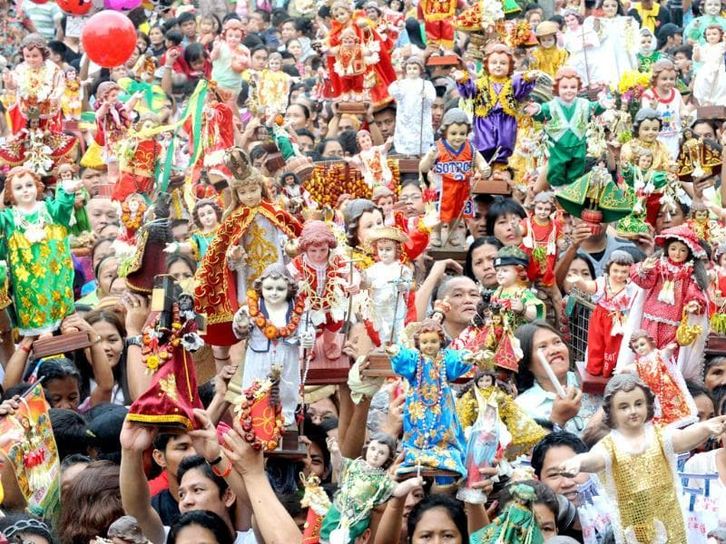 Thousands of residents of Manila's Tondo district carry small religious icons of baby Jesus in the annual Sto Nino feast. AFP photo/Jay Directo