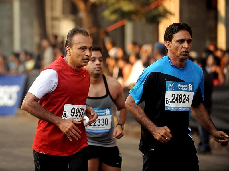 Anil Ambani runs during the Standard Chartered Mumbai Marathon 2012, in Mumbai. AFP PHOTO/Punit Paranjpe