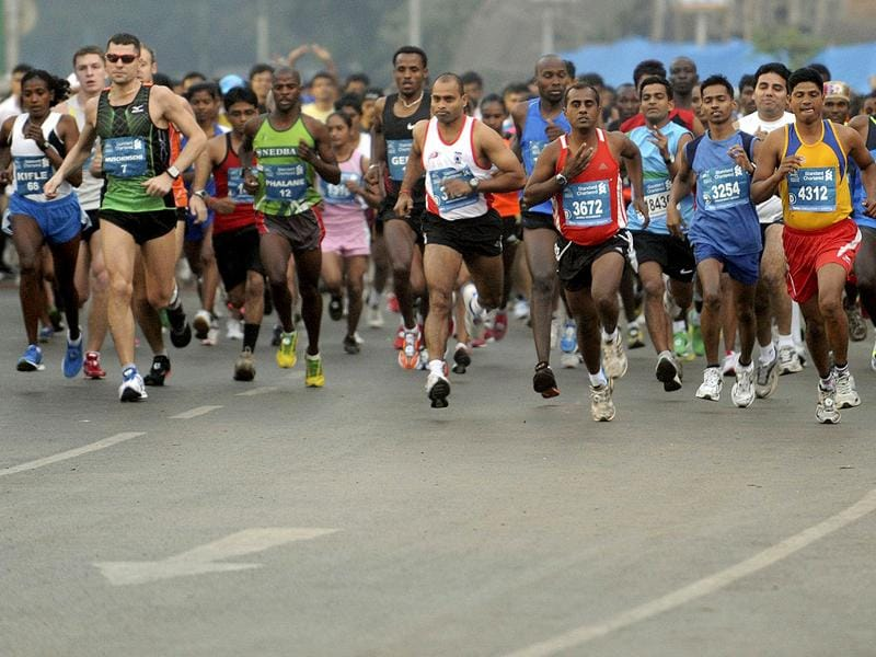 International athletes participate in the Standard Chartered Mumbai Marathon 2012, in Mumbai. AFP PHOTO/Punit Paranjpe