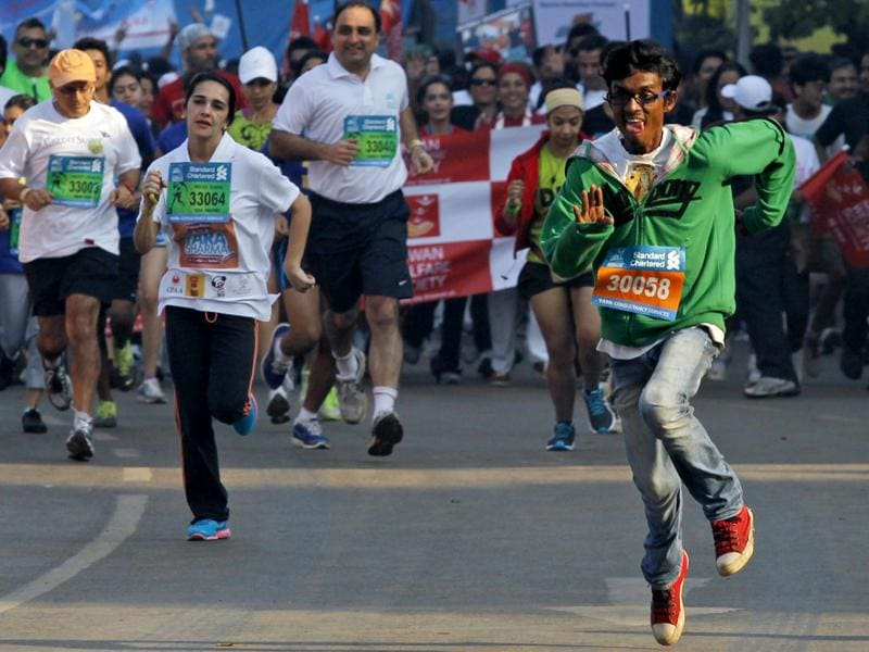 Participants run during the 6-km (10-mile) Dream Run event of the Mumbai Marathon. Reuters/Danish Siddiqui