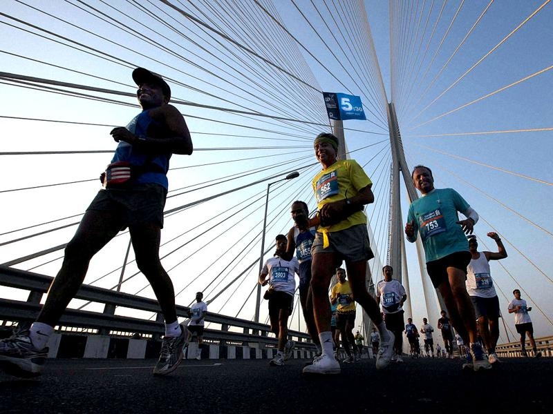 Athletes participate in the Standard Chartered Mumbai Marathon 2012 run on the Worli sea link in Mumbai. PTI Photo/by Shashank Parade