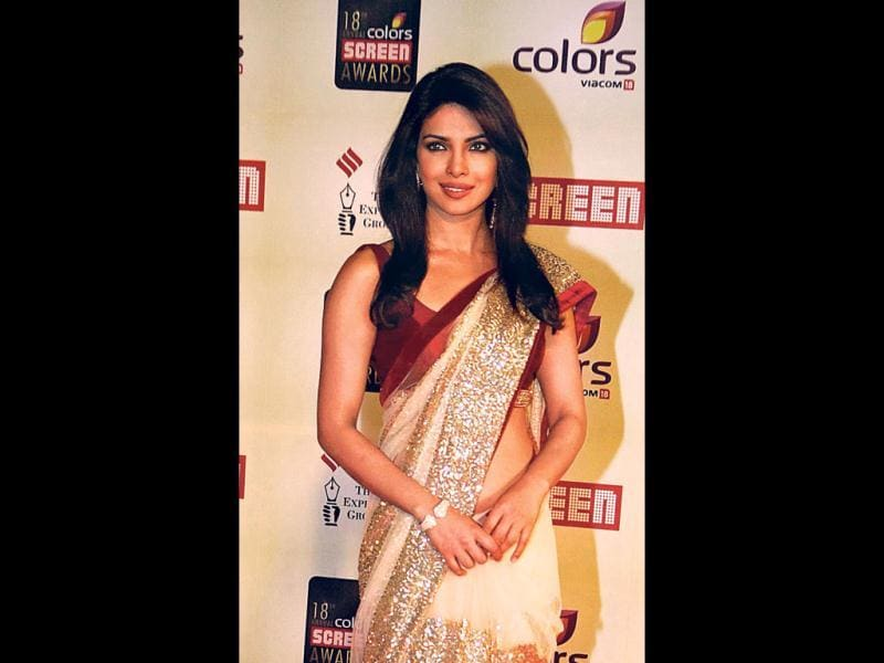 Priyanka Chopra manages to carry off a rather average saree design with elan. (HT Photo: Prodip Guha)