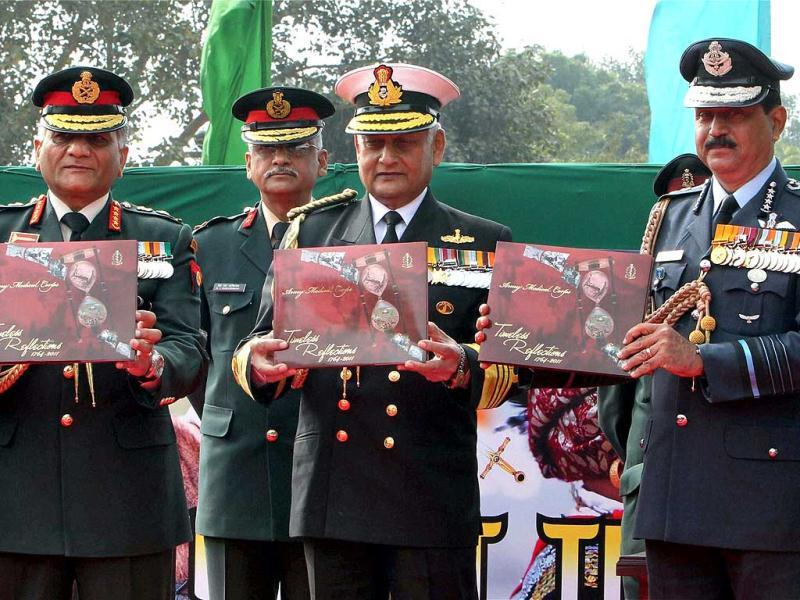 Army Chief General VK Singh (L), Navy Chief Admiral Nirmal Verma (C) and Air Chief Marshal NAK Browne, Chief of Air Staff, release a book after Army Day Parade in New Delhi. PTI Photo/Atul Yadav.