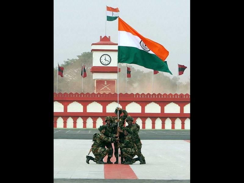 Army soldiers hold a Tricolour at a ceremony on the occasion of Army Day in New Delhi. PTI Photo/Atul Yadav.