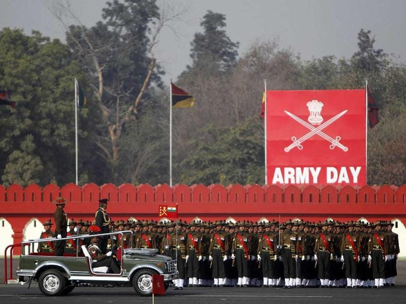 Army Chief Gen. VK Singh, second left, inspects the guard of honour on the occasion of Army Day in New Delhi. AP Photo/Mustafa Quraishi.