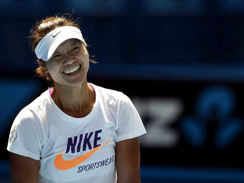 Li Na of China smiles during a practice session before the Australian Open tennis tournament in Melbourne. Reuters/Darren Whiteside