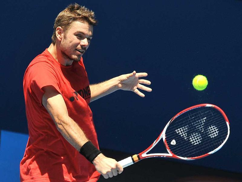 Stanislas Wawrinka of Switzerland plays a stroke during a training session ahead of the 2012 Australian Open tennis tournament in Melbourne. AFP Photo/Paul Crock