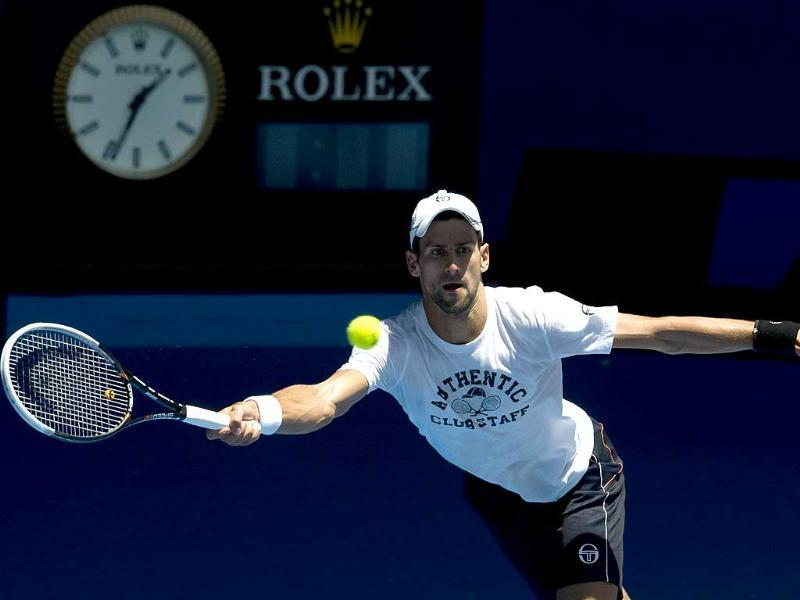 Novak Djokovic of Serbia plays a stroke during a training session ahead of the 2012 Australian Open tennis tournament in Melbourne. AFP Photo/Paul Crock
