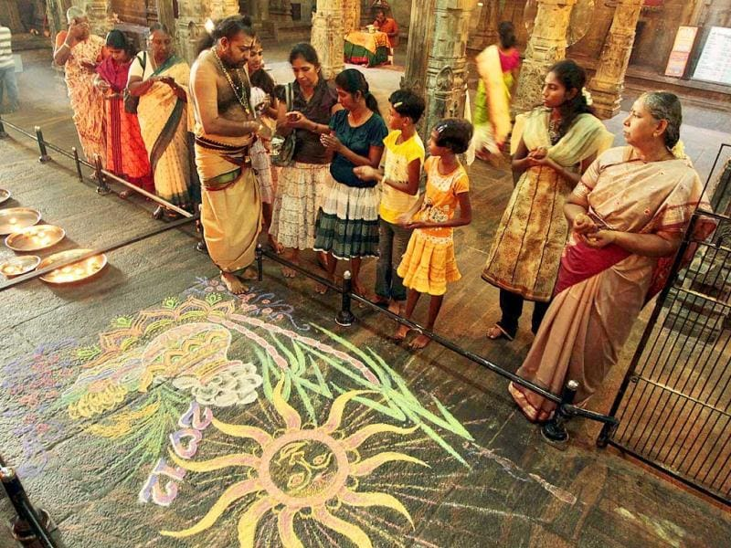 Ethnic devotees take part in Thai Pongal festival at a Hindu temple in Colombo, Sri Lanka. AP Photo
