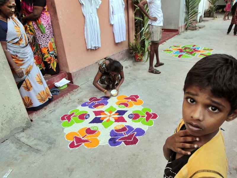 Sri Lankan ethnic Tamil Hindus decorate their houses during the Thai Pongal, a harvest festival traditionally celebrated by Tamils and dedicated to the Sun God, in Colombo, Sri Lanka. AP Photo