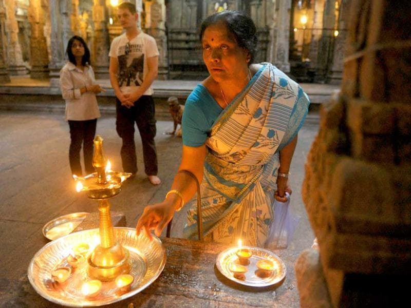 A Sri Lankan woman offers prayers at a temple in Colombo while celebrating the Thai Pongal festival. AFP Photo