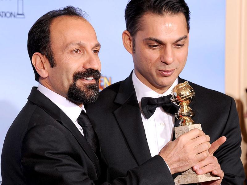 Winners for Best Foreign Language Film A Separation (Jodaeiye Nader az Simin, Iran) Director Asghar Farhadi and actor-screenwriter Peyman Moaadi (R) poses with the trophy at the 69th annual Golden Globe Awards at the Beverly Hilton Hotel in Beverly Hills, California. AFP