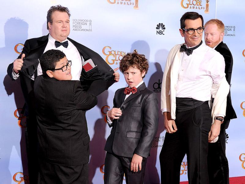 Winners for Best Television Series - Comedy or Musical Modern Family pose with the trophy at the 69th annual Golden Globe Awards at the Beverly Hilton Hotel in Beverly Hills, California. AFP