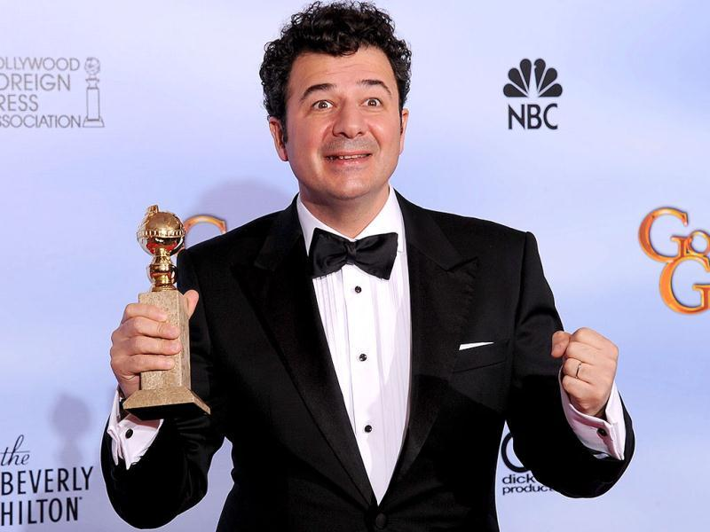 Winner for Best Original Score - Motion Picture Ludovic Bource for The Artist poses with the trophy at the 69th annual Golden Globe Awards at the Beverly Hilton Hotel in Beverly Hills, California.