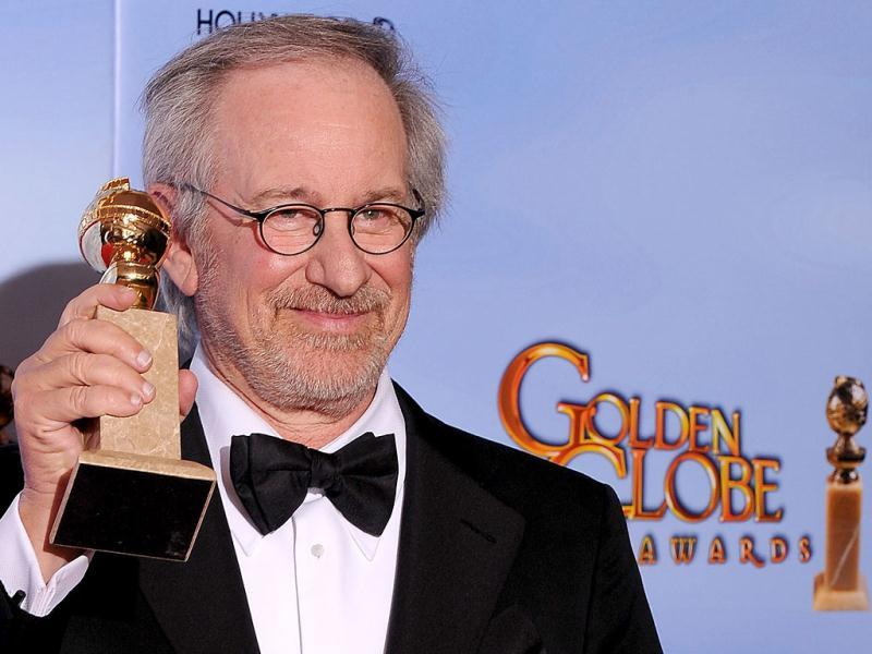 The winner for Best Animated Feature Film The Adventures of Tintin director Steven Spielberg poses with the trophy at the 69th annual Golden Globe Awards at the Beverly Hilton Hotel in Beverly Hills, California. AFP