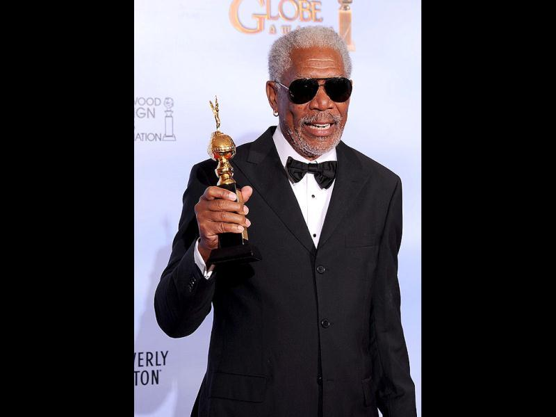 Morgan Freeman poses with the Cecil B. DeMille award at the 69th annual Golden Globe Awards at the Beverly Hilton Hotel in Beverly Hills, California. AFP
