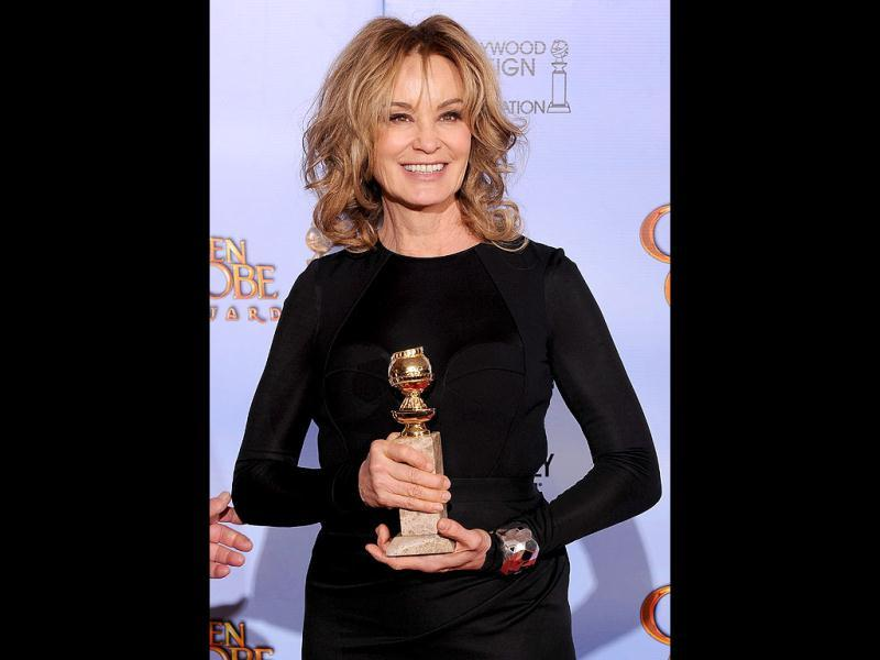 The winner for Best Performance by an Actress in a Supporting Role in a Series, Mini-Series or Motion Picture Made for Television Jessica Lange poses with the trophy at the 69th annual Golden Globe Awards at the Beverly Hilton Hotel in Beverly Hills, California. AFP