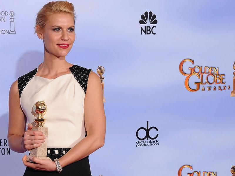 The winner for Best Performance by and Actress In a Television Series Drama Claire Danes poses with the trophy at the 69th annual Golden Globe Awards at the Beverly Hilton Hotel in Beverly Hills, California. AFP