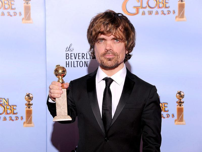The winner for Best Performance by an Actor in a Supporting Role in a Series, Mini-Series or Motion Picture Made for Television Peter Dinklage poses with the trophy at the 69th annual Golden Globe Awards at the Beverly Hilton Hotel in Beverly Hills, California. AFP