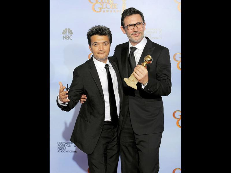 Thomas Langmann and Michel Hazanavicius pose backstage with the award for Best Motion Picture - Comedy or Musical for the film The Artist during the 69th Annual Golden Globe Awards in Los Angeles. AP