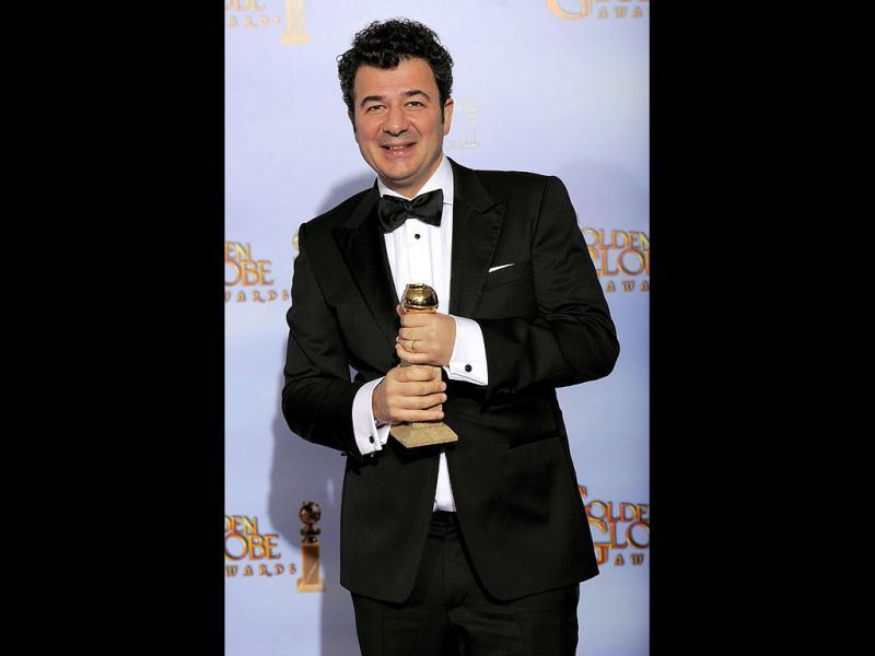 Ludovic Bource poses backstage with the award for Best Original Score in a Motion Picture for the film The Artist during the 69th Annual Golden Globe Awards in Los Angeles. AP