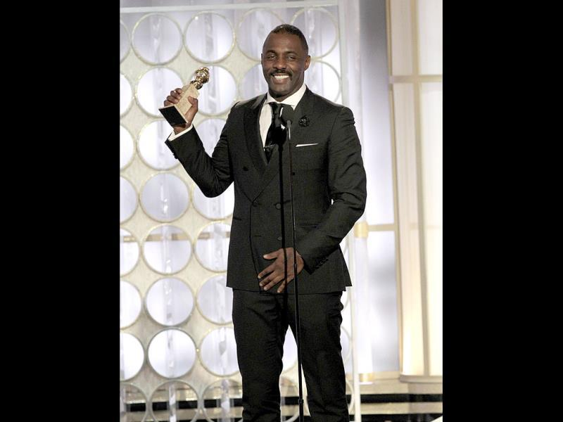 Idris Elba accepts his award for best actor - Mini-Series for the television movie Luther, during the 69th Golden Globe Awards in Beverly Hills, California. Reuters