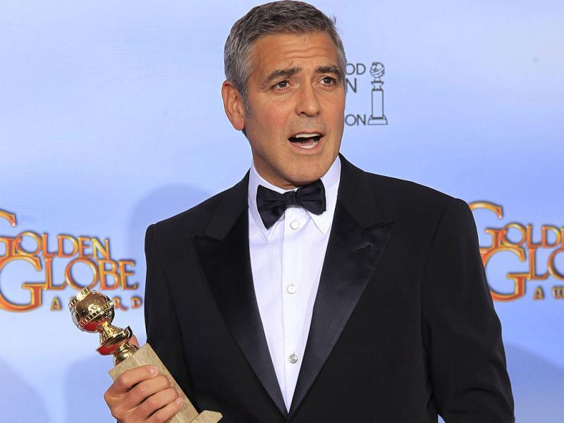 George Clooney, winner of best actor in a motion picture drama for his role in The Descendants, poses in the photo room at the 69th annual Golden Globe Awards in Beverly Hills, California. Reuters