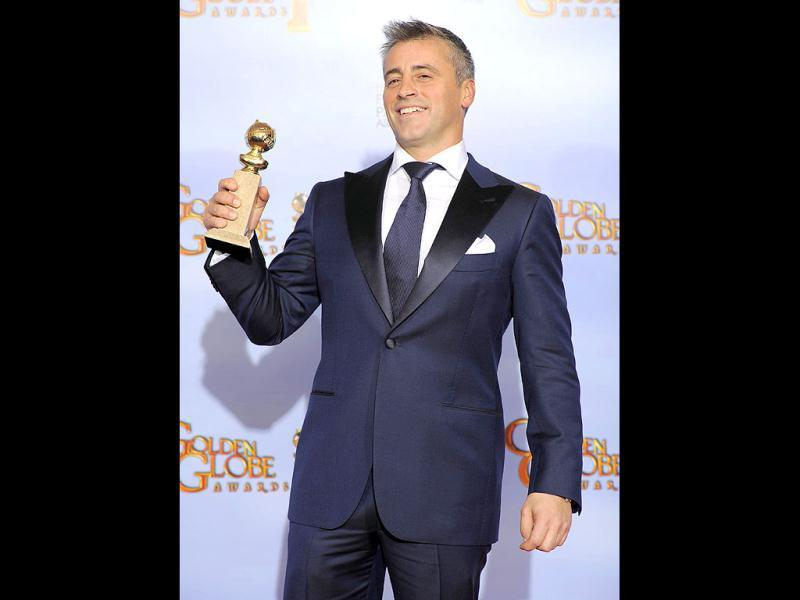 Matt LeBlanc poses backstage with the award for Best Actor in a TV Series, Comedy or Musical for Episodes during the 69th Annual Golden Globe Awards in Los Angeles. AP Photo