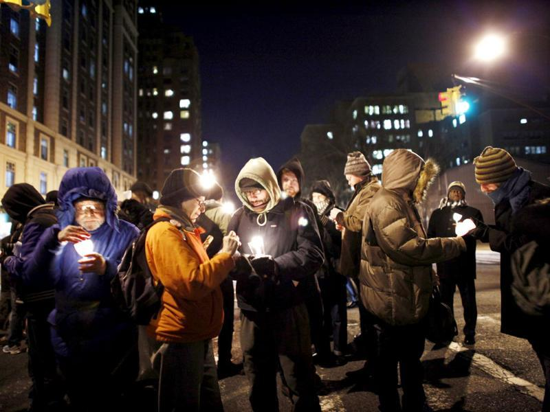 Occupy Wall Street members light candles during a march to honor Rev. Martin Luther King, Jr. in New York. (Reuters)