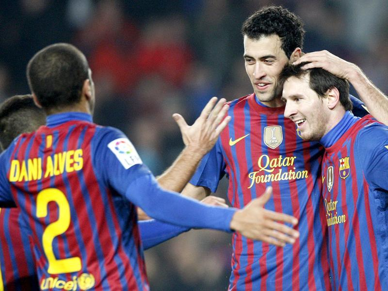 Barcelona's Dani Alves (L), Sergio Busquets (C) and Lionel Messi (R) celebrate a goal against Betis during their Spanish First division soccer match at Camp Nou stadium in Barcelona. (Reuters)