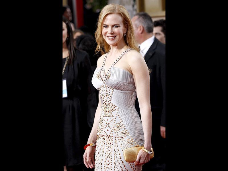 Nicole Kidman opted for an off-white oyster coloured gown with golden studded detail by Versace, which complemented her hair colour and she stepped out with husband Keith Urban. (Reuters)